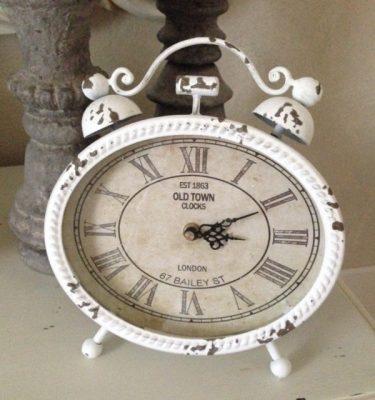 orologio-ovale-con-piedini-fileminimizer